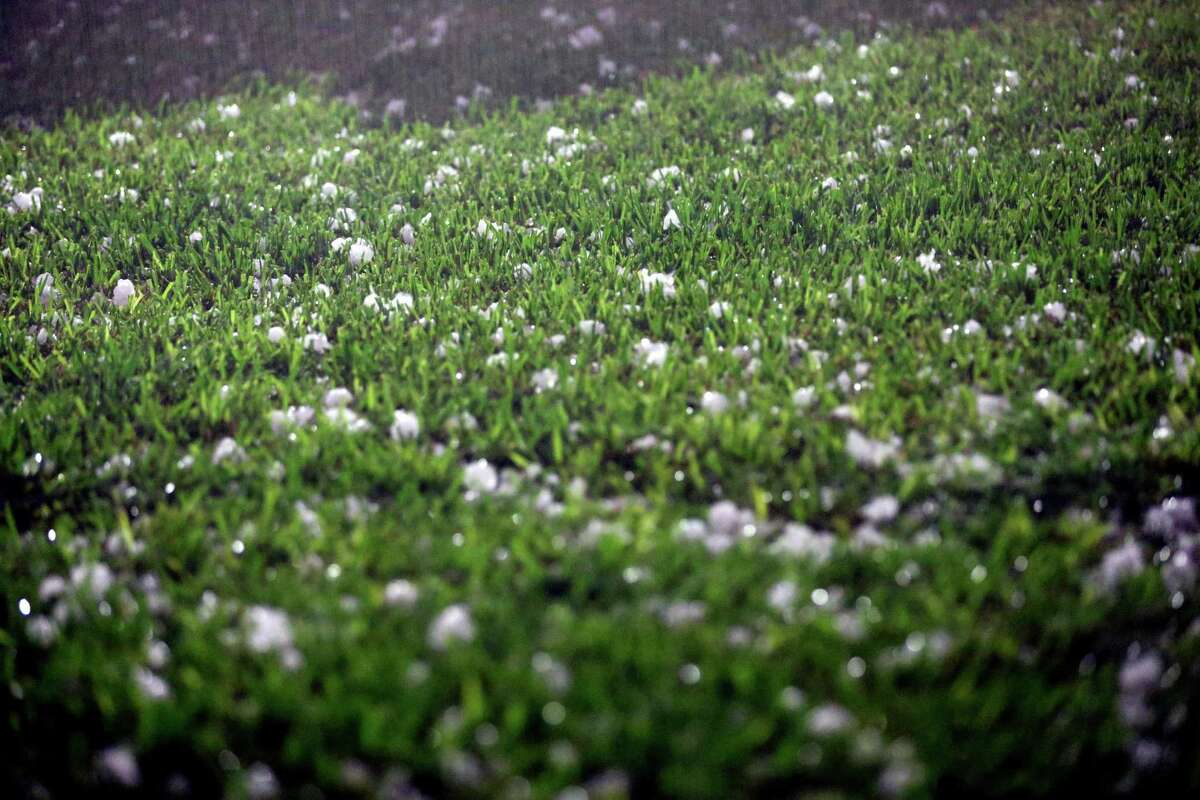 Golf ball-sized hail that fell about 10 p.m. April 11, 2016 covers the back yard of a home near the intersection of Nacogdoches and Loop 410 in San Antonio.