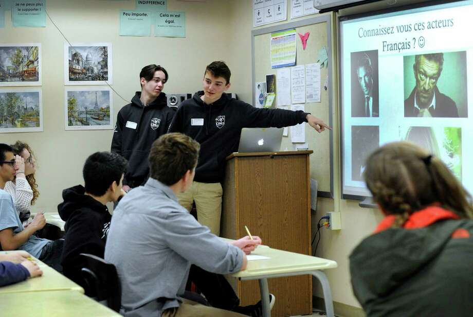 Charlie Le Mouroux, left, and Stan de Baudus, both 15, are students from France, talking about French films with a class at Joel Barlow High School in Redding on Tuesday. Photo: Carol Kaliff / Hearst Connecticut Media / The News-Times