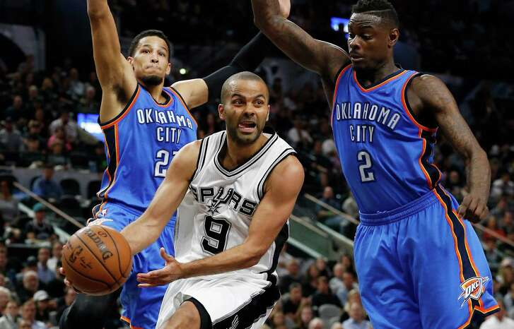 Spurs' Tony Parker looks to pass the ball against Oklahoma City Thunder's Andre Roberson (left), a former Wagner High School star, and Anthony Morrow at the AT&T Center on April 12, 2016.
