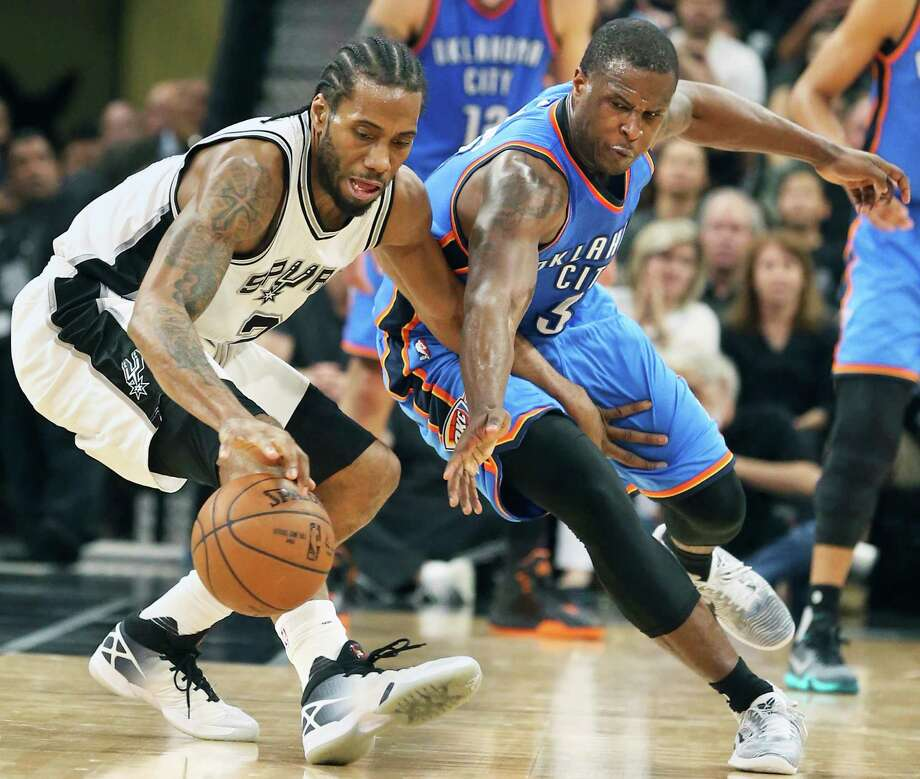 Dion Waiters tries unsuccessfully to steal the ball from Kawhi Leonard as the Spurs host Oklahoma at the AT&T Center on April 12, 2016. Photo: Tom Reel /San Antonio Express-News / 2016 SAN ANTONIO EXPRESS-NEWS