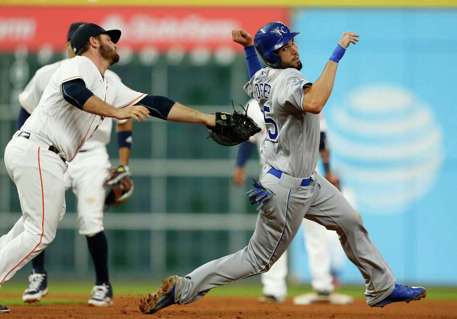 The Royals' Eric Hosmer, right, tries to outrun Astros first baseman Tyler White but is unable to avoid being caught to complete a double play in the sixth inning. Photo: Karen Warren, Staff / © 2016 Houston Chronicle