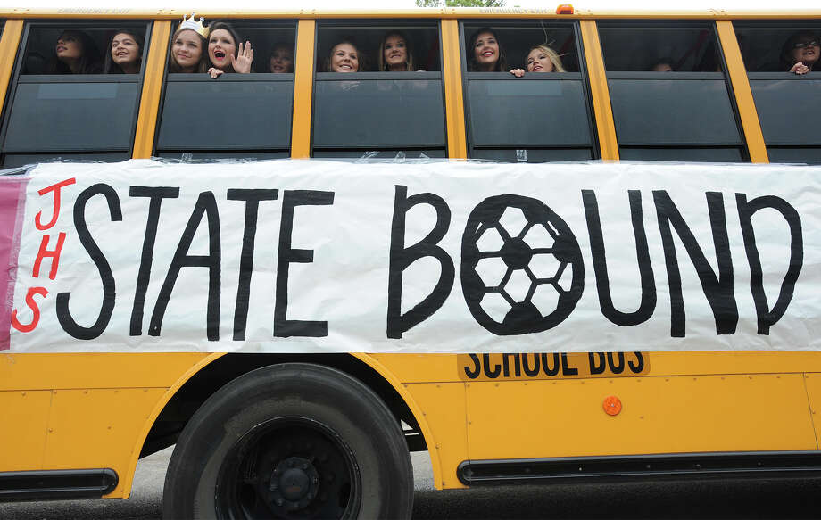 Several players on the Jasper girl's soccer team wave goodbye Tuesday as they leave the school headed for this week's playoff games. The girls will play Salado at 11 a.m. today in Georgetown.  Photo taken Tuesday, April 12, 2016 Guiseppe Barranco/The Enterprise Photo: Guiseppe Barranco, Photo Editor