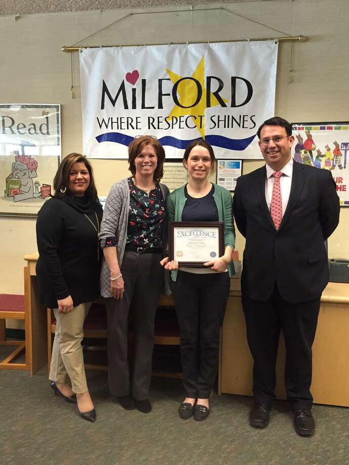 From left are Milford Human Resources Director Tania Barnes, Library Director Christine Angeli, Suzanne Harrison-Thomas and Mayor Ben Blake. Harrison-Thomas was selected as the Milford City Employee of the Month, it was announced on Friday, April 8, 2016. Photo: Contributed Photo