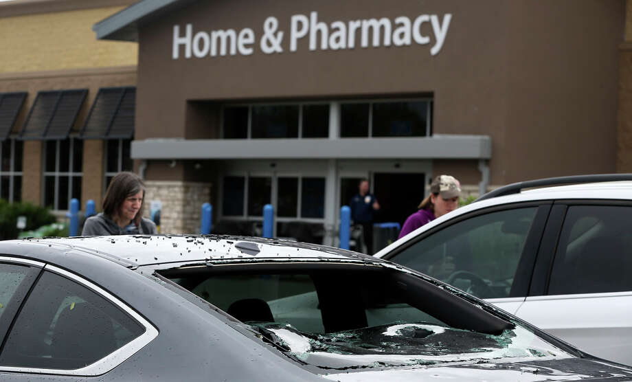 A Honda damaged by hail is in the Wal-Mart parking lot in Helotes after a storm swept through the area last night. Photo: John Davenport, San Antonio Express-News / ©San Antonio Express-News/John Davenport