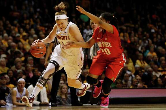 Minnesota guard Rachel Banham (1) drives the ball past Ohio State guard Asia Doss (20) in the second half of an NCAA college basketball game, in Minneapolis. Banham has earned a spot on The Associated Press All-America team and could be a target for the Stars in the draft.