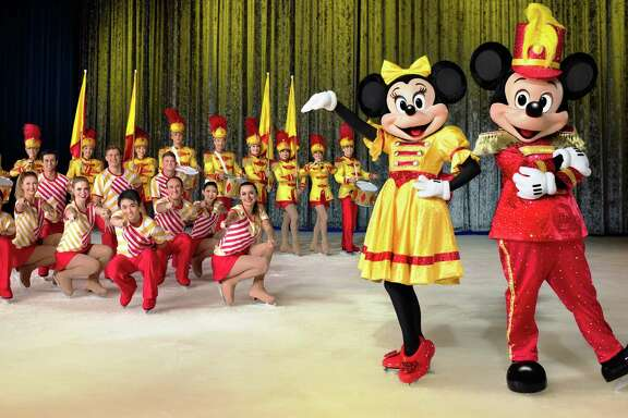"""Mickey and Minnie skate into action when Disney on Ice brings """"100 Years of Magic"""" to Houston."""