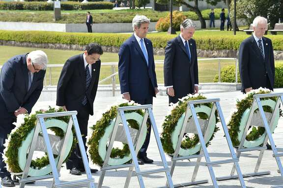 TOPSHOT - (L to R) Germany's Foreign Minister Frank-Walter Steinmeier, Japan's Foreign Minister Fumio Kishida, US Secretary of State John Kerry, British Foreign Secretary Philip Hammond and Canada's Foreign Minister Stephane Dion offer a silent prayer at the Memorial Cenotaph for the 1945 atomic bombing victims in the Peace Memorial Park, on the sidelines of the G7 Foreign Ministers' Meeting in Hiroshima on April 11, 2016. Kerry and other G7 foreign ministers made the landmark visit on April 11 to the memorial site for the world's first nuclear attack in Hiroshima.   / AFP PHOTO / POOL / Kazuhiro NOGIKAZUHIRO NOGI/AFP/Getty Images