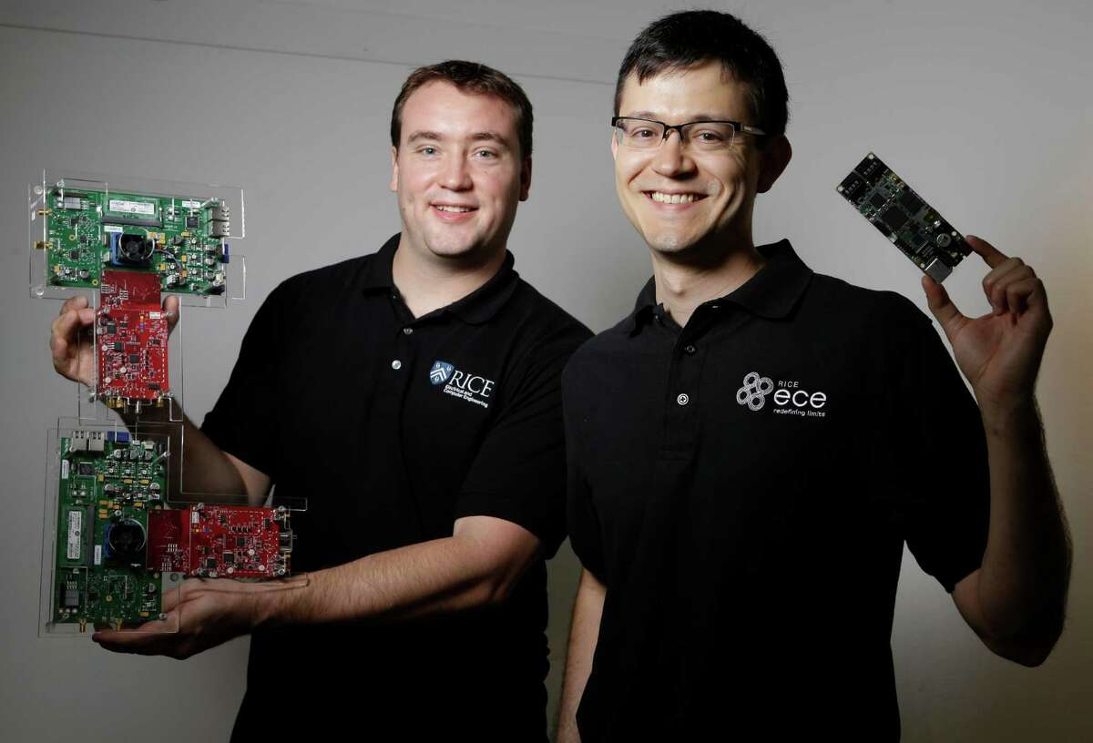Clayton Shepard, left, CTO of Skylark Wireless, holds an orginial prototype while Ryan Guerra, right, CEO of Skylark Wireless, holds the production size of their long radio for last-mile broadband internet connectivity shown Tuesday, April 12, 2016, in Houston. They will participate in the Rice Business Plan Competition.