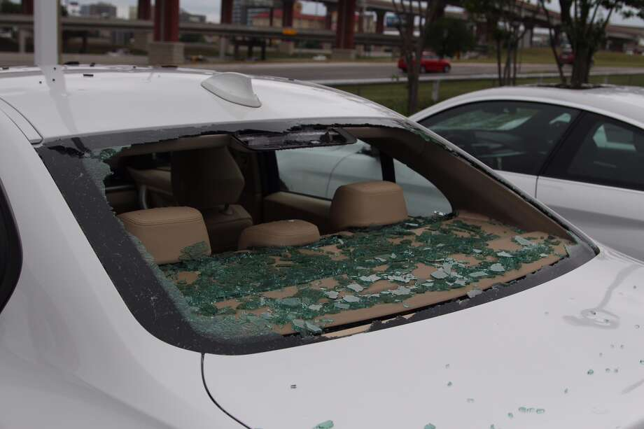 Hail storms that swept through San Antonio on April 12, 2016, hit the city hard, and damaged a number of cars on the BWM of San Antonio lot, denting hoods and knocking out windshields. Photo: Tyler White/San Antonio Express-News