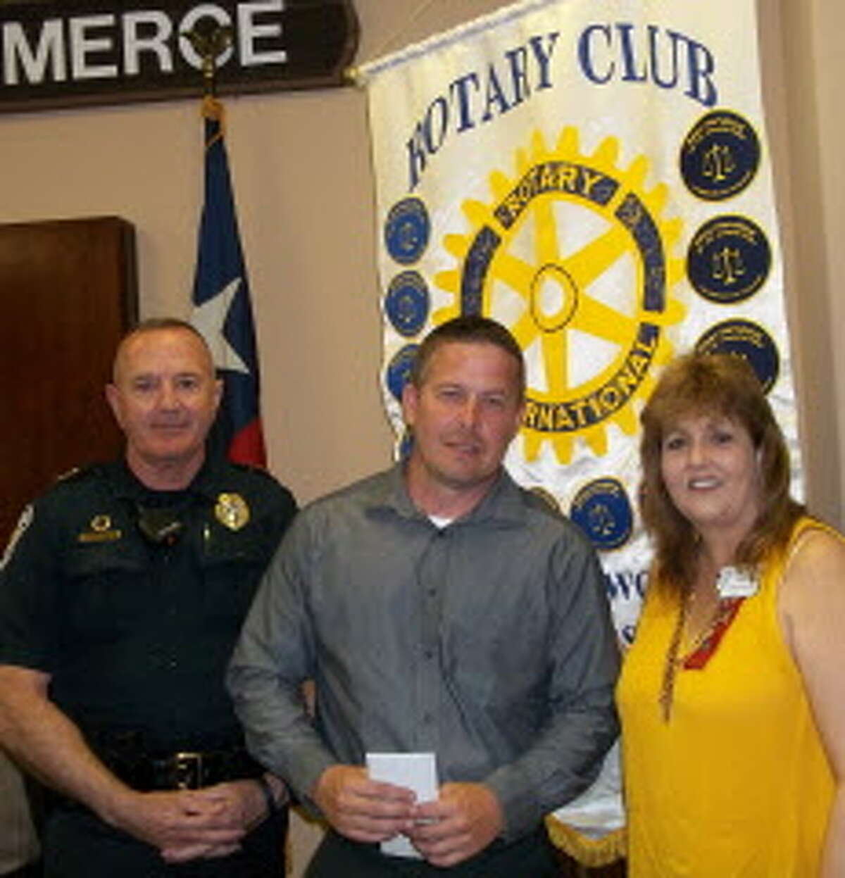 Friendswood Police Department officer John Elliott, center, was recognized recently by the Rotary Club of Friendswood for his work as a narcotics investigator. With him are Police Chief Bob Wieners and Rotary Club President Carolyn Zimmer.