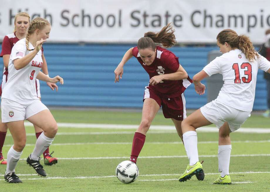 Jasper Bulldogs sophomore forward Julie Carter (1) fights for control of the ball during the first half of the Class 4A girls state semifinal soccer game between the Salado Eagles and the Jasper Bulldogs at Birkelbach Field in Georgetown, Texas, on Wednesday, April 13, 2016. Photo: Scott W. Coleman / © 2016 Scott W. Coleman, all rights reserved.