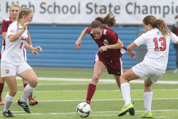 Jasper Bulldogs sophomore forward Julie Carter (1) fights for control of the ball during the first half of the Class 4A girls state semifinal soccer game between the Salado Eagles and the Jasper Bulldogs at Birkelbach Field in Georgetown, Texas, on Wednesday, April 13, 2016.