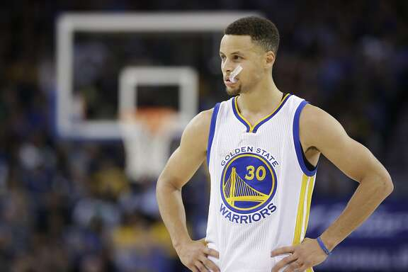 In this Friday, April 1, 2016 photo, Golden State Warriors' Steph Curry (30) pauses during an NBA basketball game against the Boston Celtics in Oakland, Calif. Though he moved on to the NBA long ago, March Madness is also Curry's world now. (AP Photo/Marcio Jose Sanchez)