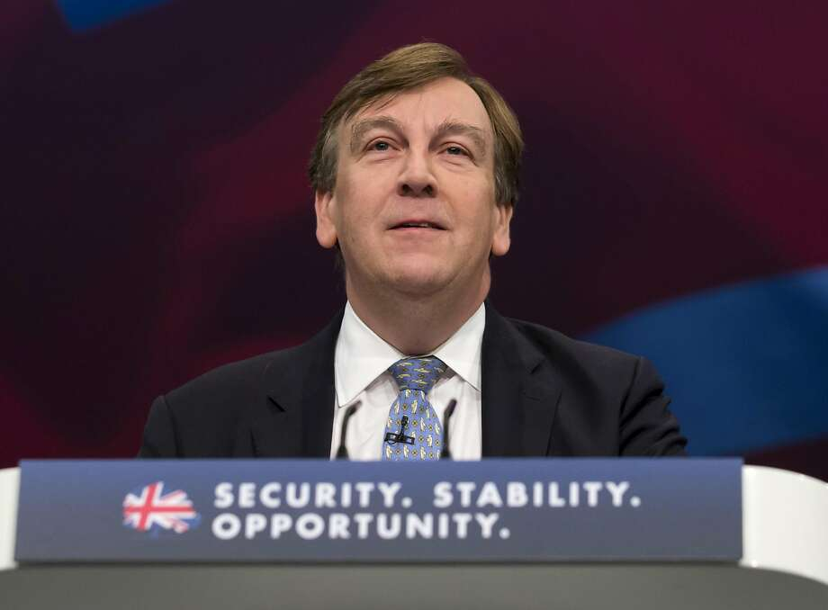 British Culture Secretary John Whittingdale is being pressured to resign after reports surfaced about his relationship with a sex worker. Photo: Jon Super, AP