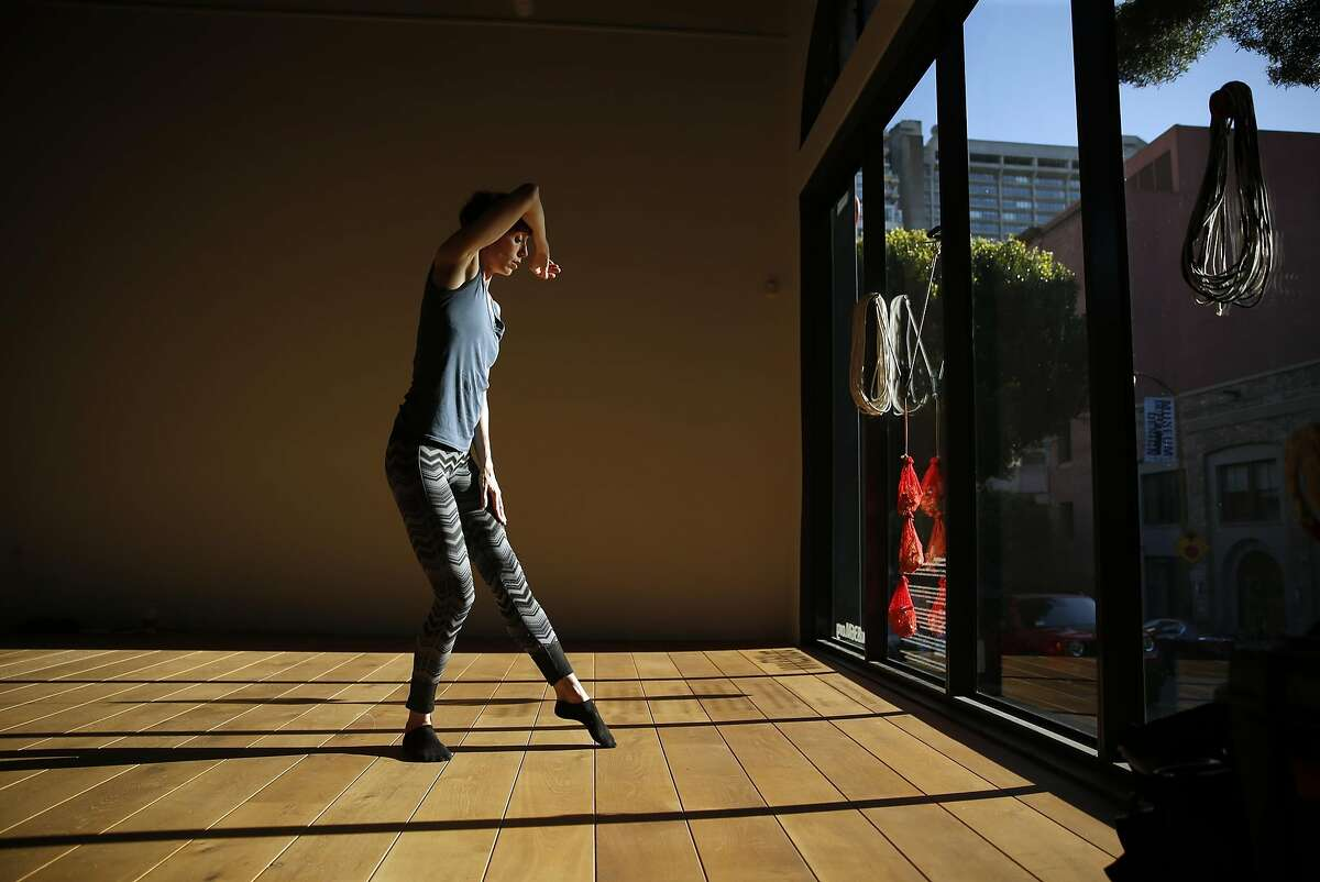 Wendy Rein dances as RAWdance SF rehearses in front area of 836M gallery on Montgomery Street in San Francisco, Calif., on Tuesday, March 15, 2016.