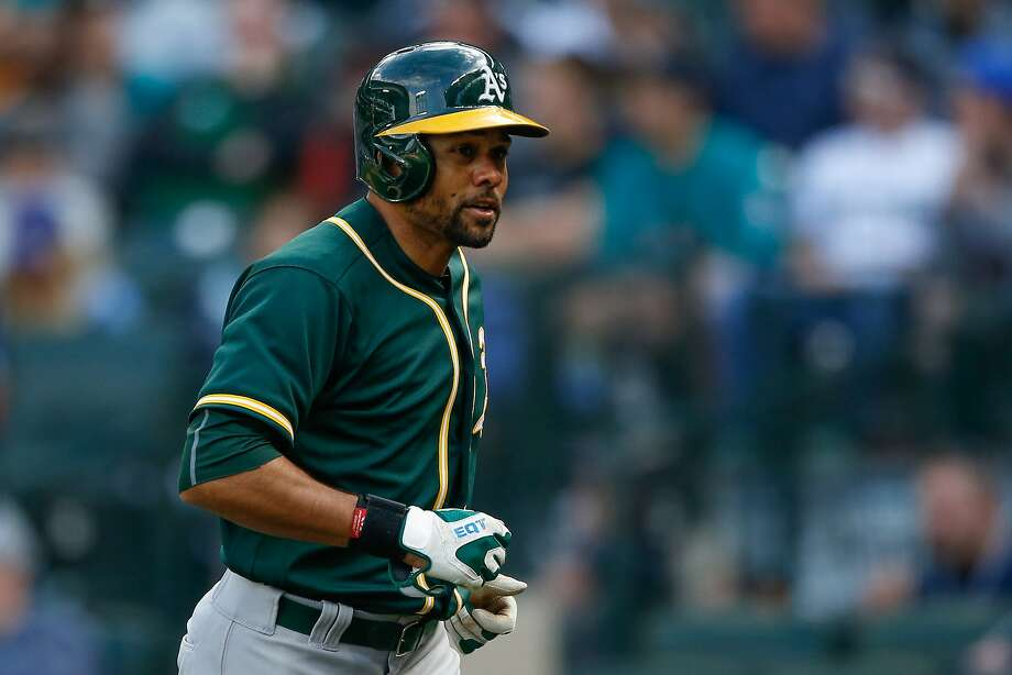 SEATTLE, WA - APRIL 10:  Coco Crisp #4 of the Oakland Athletics heads to the dugout after hitting a game-winning solo home run in the tenth inning to defeat the Seattle Mariners 2-1 at Safeco Field on April 10, 2016 in Seattle, Washington.  (Photo by Otto Greule Jr/Getty Images) Photo: Otto Greule Jr, Getty Images