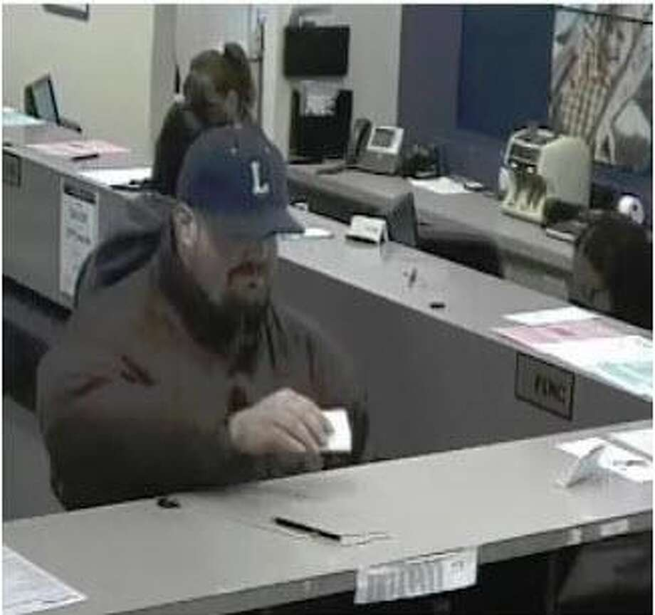 Milford police are looking for a suspect who they say robbed a People's United Bank on Broad Street Tuesday afternoon. Photo: Contributed Photo / Milford Police Department