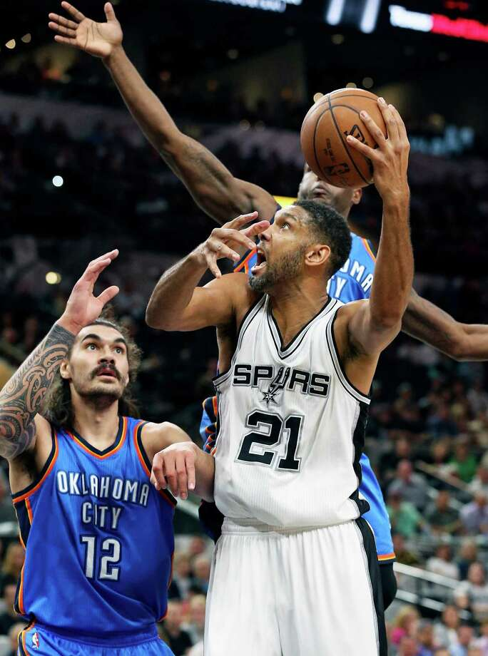 Tim Duncan gets off a shot in front of Steven Adams as the Spurs host Oklahoma at the AT&T Center on April 12, 2016. Photo: TOM REEL, STAFF / SAN ANTONIO EXPRESS-NEWS / 2016 SAN ANTONIO EXPRESS-NEWS