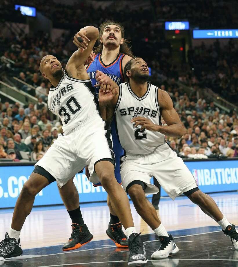David West and Kawhi Leonard box out Steven Adams as the Spurs host Oklahoma at the AT&T Center on April 12, 2016. Photo: TOM REEL, STAFF / SAN ANTONIO EXPRESS-NEWS / 2016 SAN ANTONIO EXPRESS-NEWS
