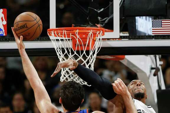 Spurs' David West (30) defends against Oklahoma City Thunder's Nick Collison (04) at the AT&T Center on Tuesday, Apr. 12, 2016. Spurs defeated the Thunder, 102-98, in overtime. (Kin Man Hui/San Antonio Express-News)