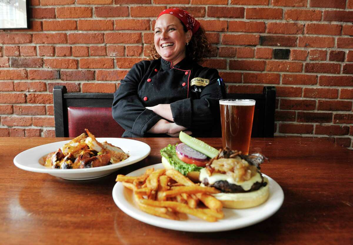 Chef Melissa Doney Sheridan, CEC, poses with a plate of jambalaya and a Uncle Sam burger at Brown's Brewing Company on Wednesday, March 23, 2016, in Troy, N.Y. (Paul Buckowski / Times Union)