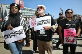Protesters in front of city hall regarding the recent San Francisco Police Department's officer-involved shooting of Luis Gongora gather in San Francisco, California on wednesday, april 13, 2016.