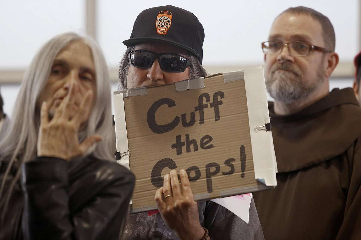 Protesters during a town hall meeting at the Union Local Hall regarding the San Francisco Police Department's officer-involved shooting of Luis Gongora, a 45-year-old homeless man in San Francisco, California on wednesday, April 13, 2016.