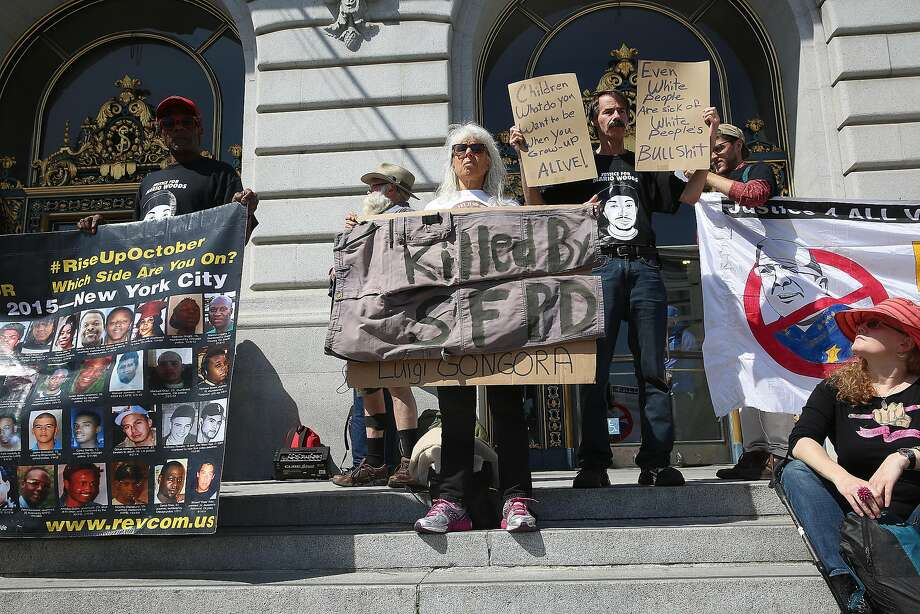 Protesters in front of city hall regarding the recent San Francisco Police Department's officer-involved shooting of Luis Gongora gather in San Francisco, California on wednesday, april 13, 2016. Photo: Liz Hafalia, The Chronicle