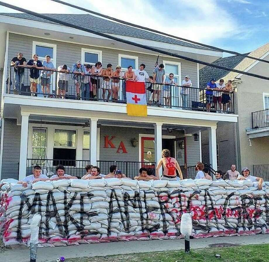 Tulane Fraternity Builds Crude Wall Around House That