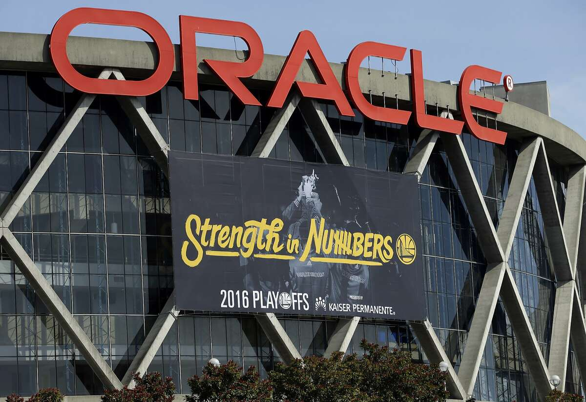 The Golden State Warriors have installed the team's 2016 playoff signage, using the Strength in Numbers slogan seen on Oracle Arena on Tuesday, April 12, 2016, in Oakland, Calif. Stephen Curry never figured the Chicago Bulls' 72-win mark could be matched or broken. Twenty years later, the reigning MVP and his defending champion Warriors are on the brink of doing just that and making yet more history this season. That chance comes Wednesday, when the Memphis Grizzlies visit as Golden State goes for win No. 73 in its final regular-season game. (AP Photo/Ben Margot)