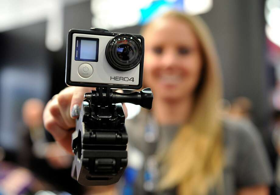 FILE - JANUARY 13, 2016: It was reported that GoPro would cut its workforce by 7 percent after poor holiday sales, and shares dove more than 20% in late trading January 13, 2015 LAS VEGAS, NV - JANUARY 06:  A GoPro Hero 4 camera is displayed at the 2015 International CES at the Las Vegas Convention Center on January 6, 2015 in Las Vegas, Nevada. CES, the world's largest annual consumer technology trade show, runs through January 9 and is expected to feature 3,600 exhibitors showing off their latest products and services to about 150,000 attendees.  (Photo by David Becker/Getty Images) Photo: David Becker
