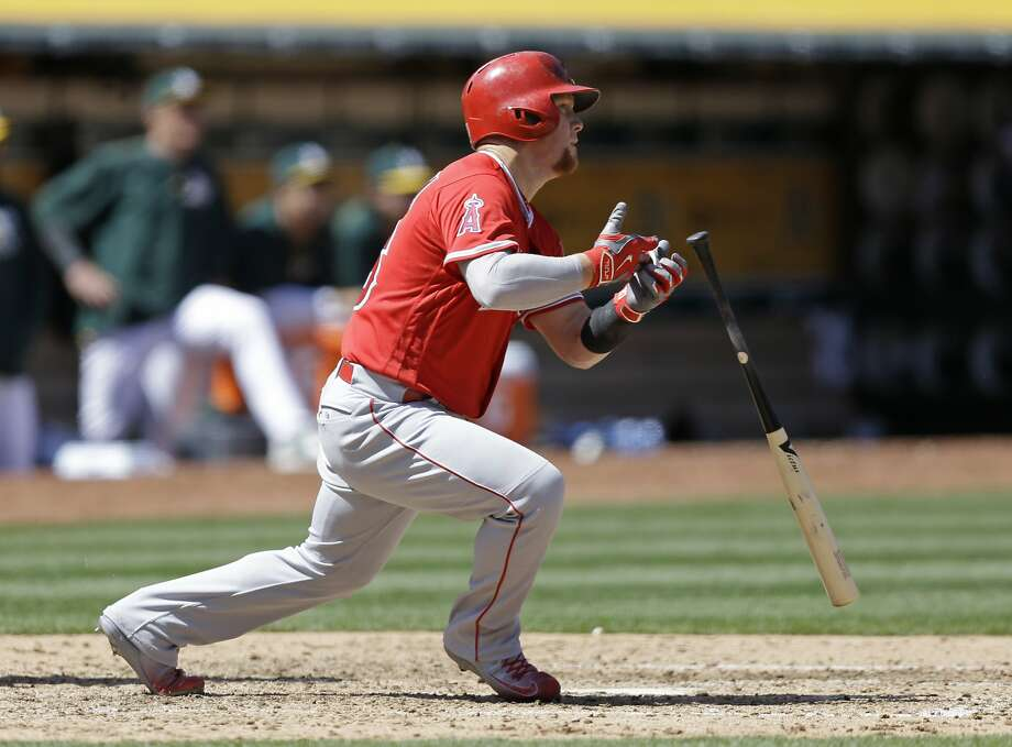 Los Angeles Angels' Kole Calhoun drops his bat after hitting an RBI single off Oakland Athletics' Eric Surkamp in the fifth inning of a baseball game Wednesday, April 13, 2016, in Oakland, Calif. (AP Photo/Ben Margot) Photo: Ben Margot, AP