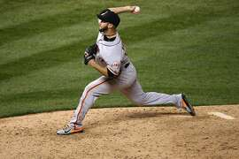 DENVER, CO - APRIL 12:  Relief pitcher George Kontos #70 of the San Francisco Giants delivers against the Colorado Rockies in the ninth inning at Coors Field on April 12, 2016 in Denver, Colorado. The Giants defeated the Rockies 7-2.