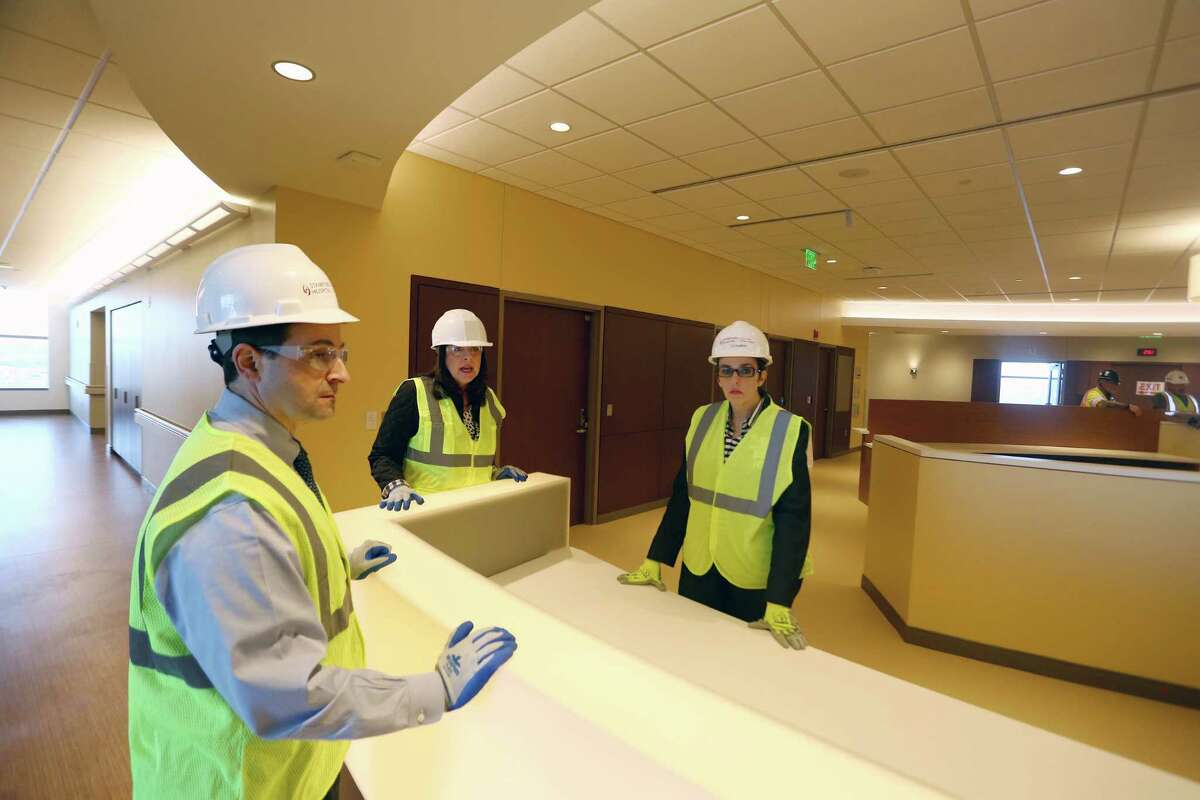 Stamford Hospital executives, from left, Director of Facilities Management Michael Smeriglio, Chief Operating Officer Kathleen Silard and Director of Critical Care Liz Longmore give a tour of the new, and still under construction, hospital on Wednesday, April 13, 2016.