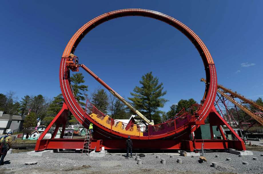 Workers assemble the new Greezed Lightnin' roller coaster ride at Six Flags Great Escape on Wednesday, April 13, 2016, in Queensbury, N.Y. The new attraction is due to debut on May 21, a week after the park opens.  (Skip Dickstein/Times Union) Photo: SKIP DICKSTEIN / 10036185A