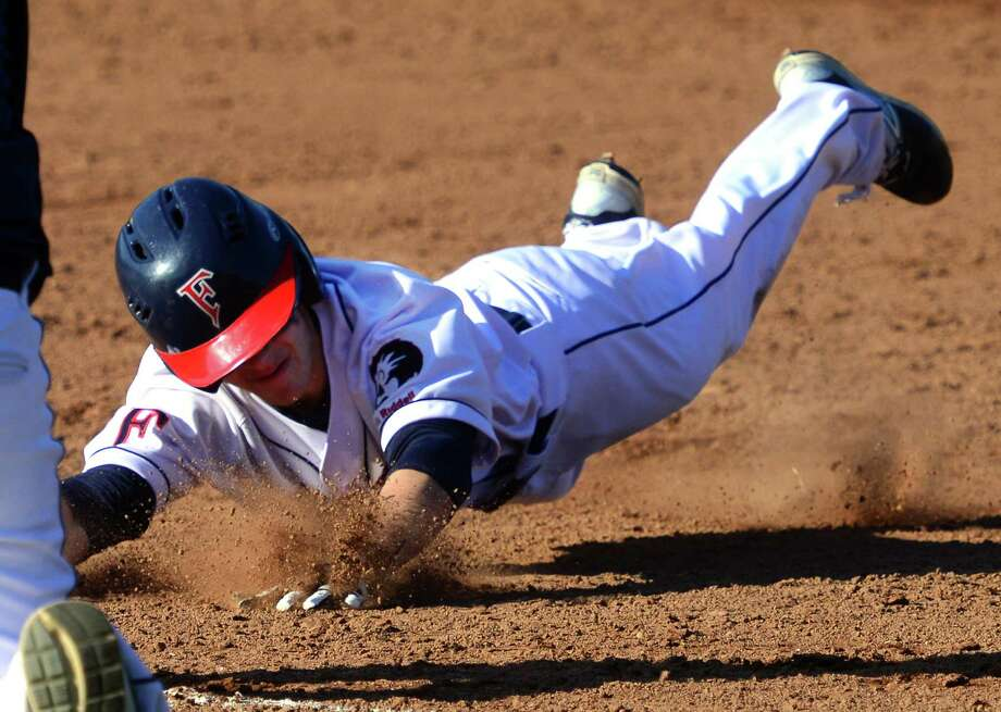 Foran's Maxwell Gorlick slides into third base during baseball action against Jonathan Law in Milford, Conn., on Wednesday Apr. 13, 2016. Gorlick brought in the winning run off of a shot to right field by teammate Justin Lanese. Photo: Christian Abraham, Hearst Connecticut Media / Connecticut Post