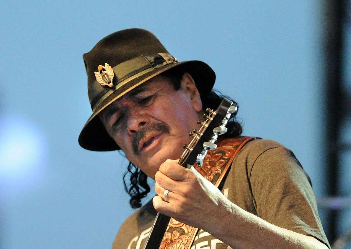 Carlos Santana performs during the Greenwich Town Party at Roger Sherman Baldwin Park, Greenwich, Conn., Saturday, May 24, 2014.