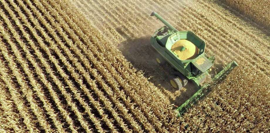 An aerial photograph shows corn harvested in Malden, Illinois. Seom U.S. food producers are seeing their sales to Mexico stall, according to industry officials. Meanwhile, Mexican buyers are telling their U.S. suppliers that they are exploring new sources of grains, corn, dairy products and meat for fear that Mexico will revive tariffs on agricultural products that went to zero after NAFTA. Photo: Daniel Acker /Bloomberg News / © 2015 Bloomberg Finance LP