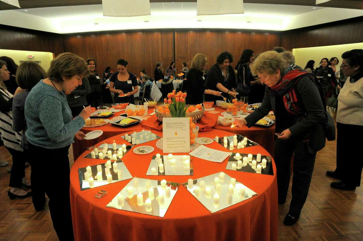 Nearly 150 women gather together at Temple Beth El in Stamford on April 13, 2016 to hold an intergenerational women's seder. The seder is a festive meal that celebrates the Jewish holiday of Passover, at which time Jews around the world retell the story of their liberation from slavery in ancient Egypt that is written about in the biblical book of Exodus.