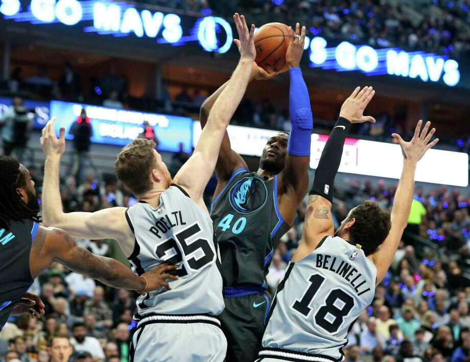 San Antonio Spurs guard Manu Ginobili, left, of Argentina fouls Dallas Mavericks guard Devin Harris, right, on a shot attempt in the first half of an NBA basketball game, Tuesday, Dec. 12, 2017, in Dallas. (AP Photo/Tony Gutierrez) Photo: Tony Gutierrez, Associated Press / Copyright 2017 The Associated Press. All rights reserved.