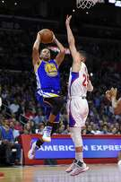 Golden State Warriors guard Stephen Curry, left, goes up for a shot as Los Angeles Clippers guard Austin Rivers defends during the second half of an NBA basketball game, Thursday, Nov. 19, 2015, in Los Angeles. The Warriors won 124-117. (AP Photo/Mark J. Terrill)