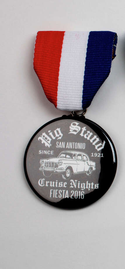Fiesta medal collector Jerry Clayworth produces medals, too, and some pay tribute to old San Antonio spots. This was one of two Pig Stand medals. Photo: JUANITO M GARZA / San Antonio Express-News / San Antonio Express-News