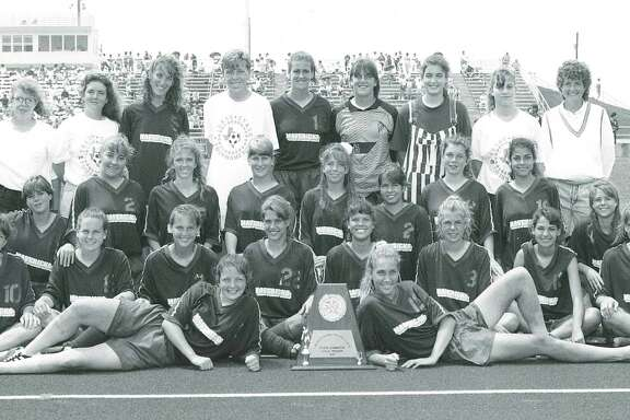 Team photo of the Madison girls soccer team after it won the 1991 UIL state championship.