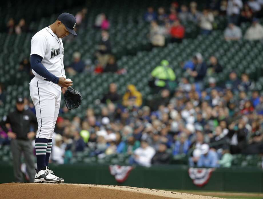 Seattle Mariners starting pitcher Taijuan Walker stands on the mound in the first inning of a baseball game against the Texas Rangers as he waits for Mariners pitching coach Mel Stottlemyre to arrive for a conference, Wednesday, April 13, 2016, in Seattle. (AP Photo/Ted S. Warren)