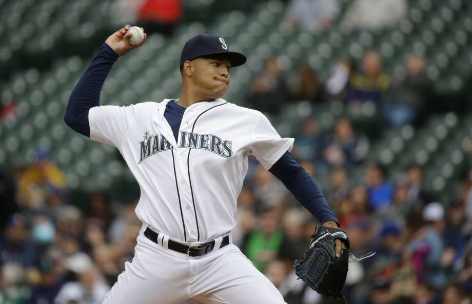 Seattle Mariners starting pitcher Taijuan Walker throws against the Texas Rangers in the first inning of a baseball game, Wednesday, April 13, 2016, in Seattle. (AP Photo/Ted S. Warren)