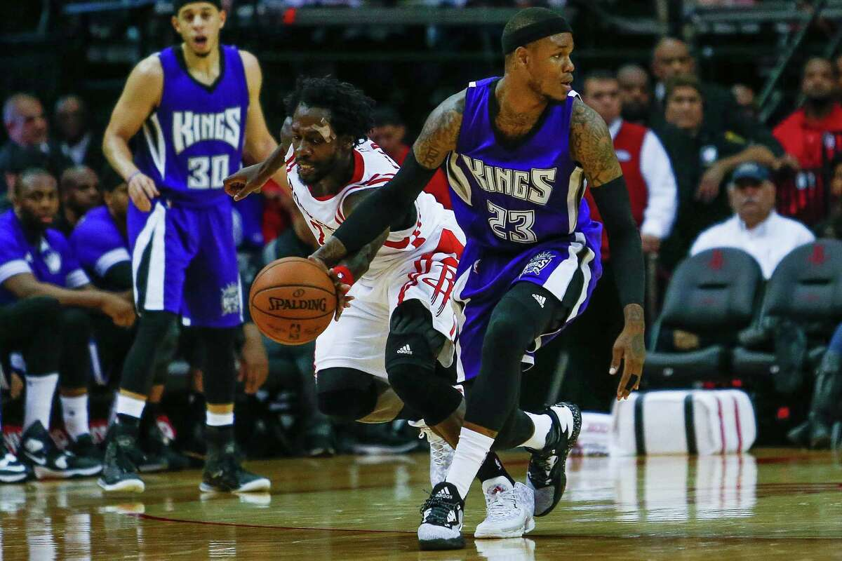 Houston Rockets guard Patrick Beverley (2) steals the ball from Sacramento Kings guard Ben McLemore (23) as the Houston Rockets take on the Sacramento Kings at the Toyota Center Wednesday, April 13, 2016 in Houston.