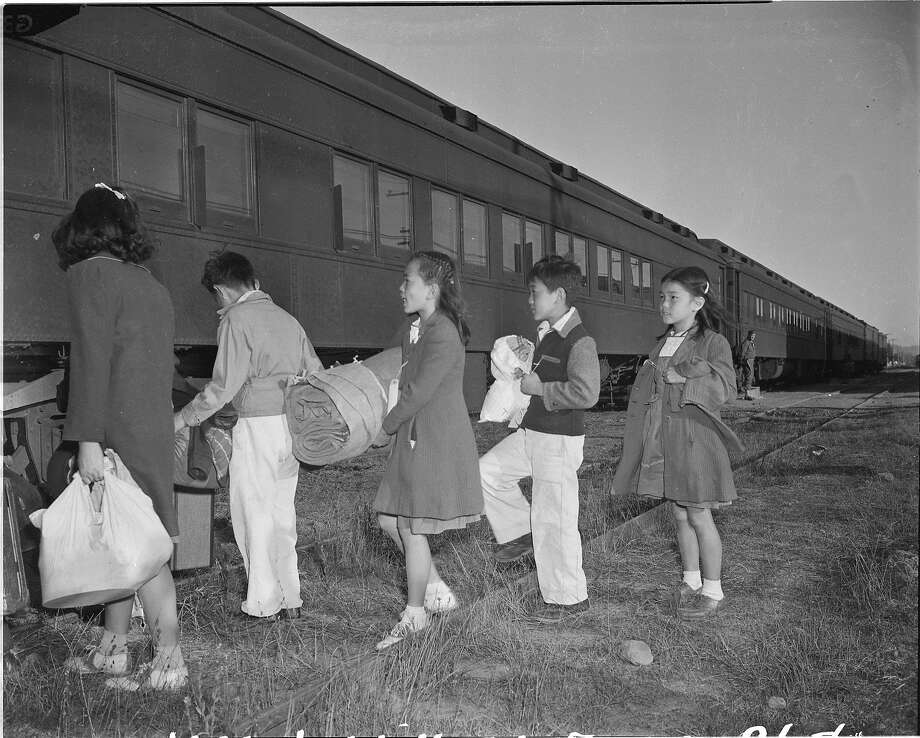 San Francisco-born Japanese children hop on a train from Tanforan Park to Utah, switching internment camps in 1942. Photo: Chronicle File, The Chronicle