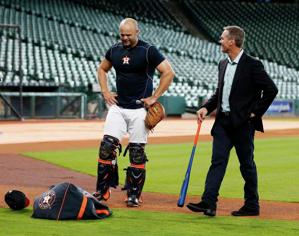 Houston Astros Evan Gattis talks with Craig Biggio after working out at catcher during an early