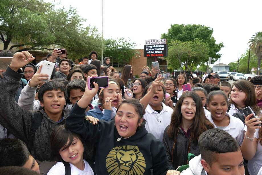 """Rhodes Middle School students chant """"Bring him back,"""" referring to fired police officer Joshua Kehm, who threw 12-year-old student Janissa Valdez to the ground on March 29. Photo: Billy Calzada /San Antonio Express-News / San Antonio Express-News"""
