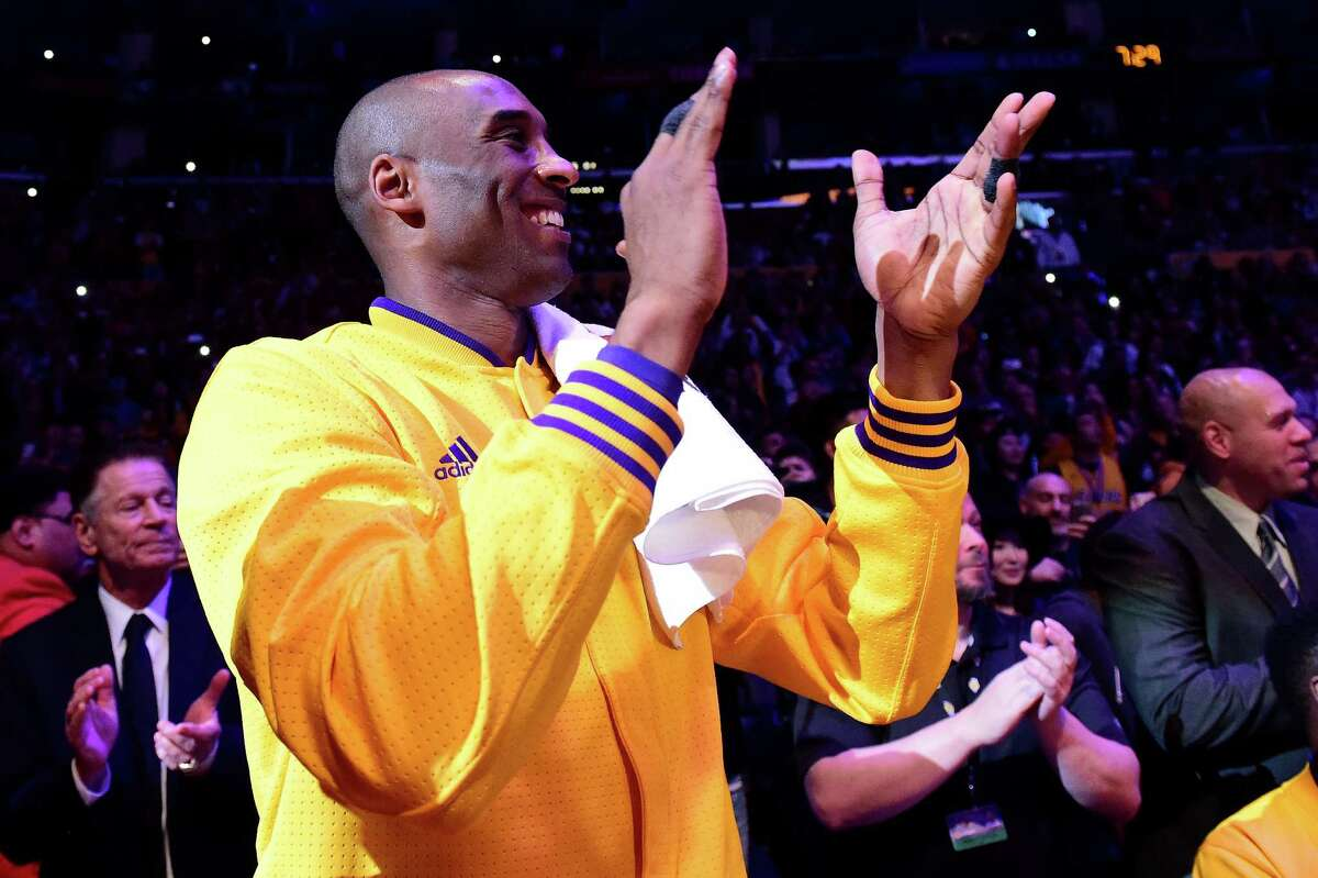 LOS ANGELES, CA - APRIL 13: Kobe Bryant #24 of the Los Angeles Lakers smiles and claps before taking on the Utah Jazz in Bryant's final NBA game at Staples Center on April 13, 2016 in Los Angeles, California. NOTE TO USER: User expressly acknowledges and agrees that, by downloading and or using this photograph, User is consenting to the terms and conditions of the Getty Images License Agreement.